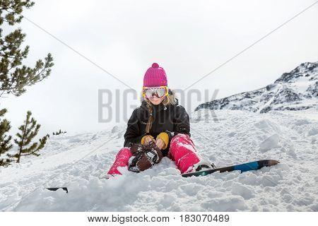 Upset Woman Snowboarder In Mountains
