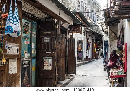 Zanzibar, Tanzania - July 14, 2016: City centre of Zanzibar, local streets, shpos and shacks opened for public, Tanzania