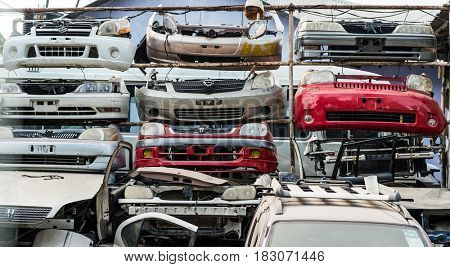 Zanzibar, Tanzania - July 14, 2016: Parts of old rusty cars used as fencing in Zanzibar, Tanzania, poverty in the country