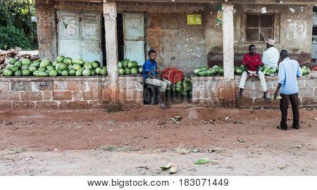 Zanzibar, Tanzania - July 14, 2016: Market in Zanzibar, Tanzania, folks selling watermelon, poor life, old shacks