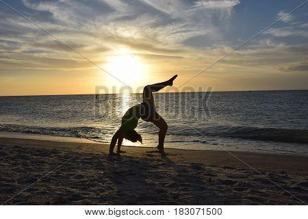 Yoga at sunset on Sand Key Beach