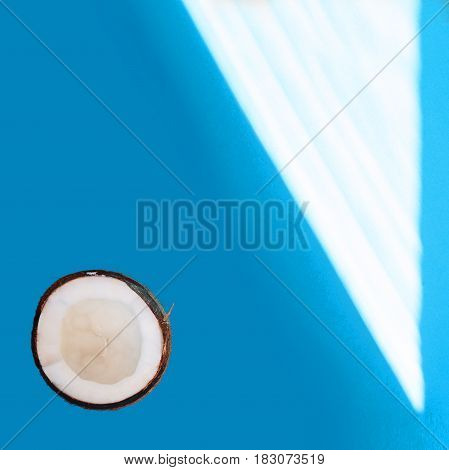 Half Coconut Isolated On Blue Background. Clipping Path