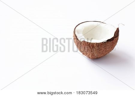 Half Of Coconut Closeup On A White Background