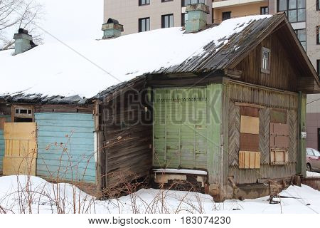 Abandoned wooden house with Boarded up windows photo