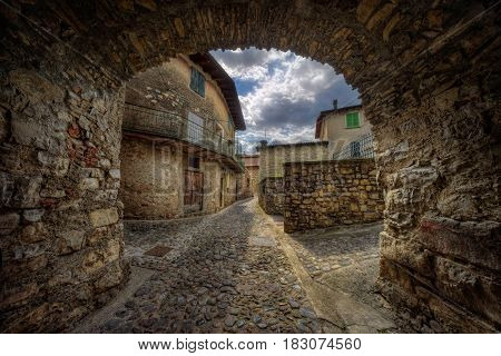 Arche on narrow stone street in Masse village on Monte Isola at Iseo Lake Italy