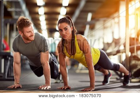 Couple on exhausting fitness training together