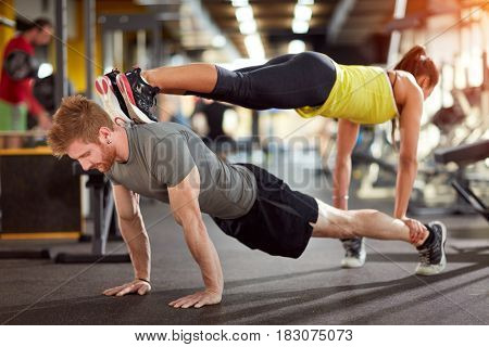 Sports couple trains together in fitness club