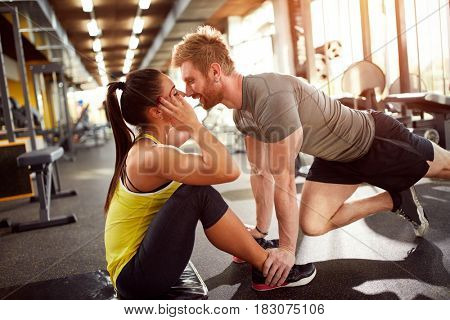 Young couple at fitness training in fitness center