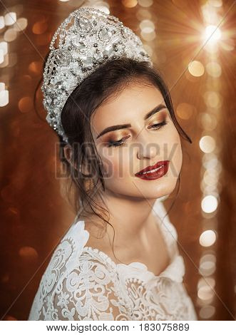 Beautiful fashion model Woman with hair, pink lipstick . Portrait of glamour girl with bright makeup. Beauty female face close up with perfect make up