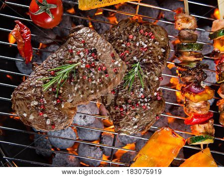 Barbecue garden grill with beef steaks, close-up.