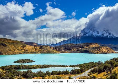 Torres del Paine National Park. The magnificent cliffs of Los Cuernos are covered with snow. Summer in the south of Chile. The concept of extreme and active tourism