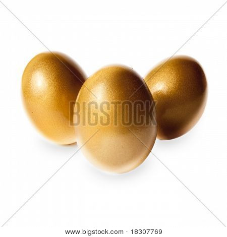 Big Golden Eggs On White Representing Wealth And Luck