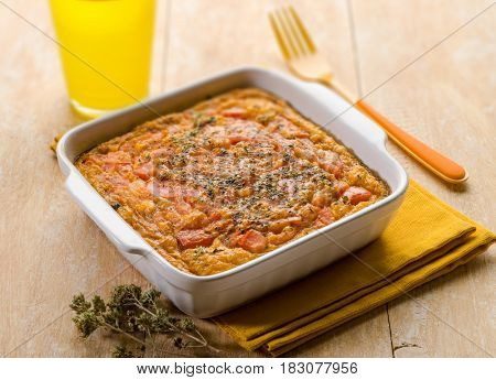 eggs quiche with tomatoes and oregano, selective focus