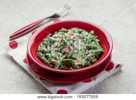 spatzli gnocchi with speck, selective focus