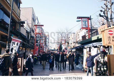 Tokyo, Japan - Feb 19,2017 - Nakamise shopping street in Asakusa, Tokyo. The busy arcade connects Senso-ji Temple to it's outer gate Kaminarimon, which can just be seen in the distance.