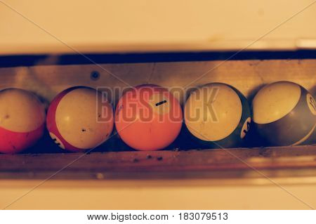Set of balls for a game of pool billiards on shelves. American pool billiard. Pool billiard game. Billiard sport concept art.