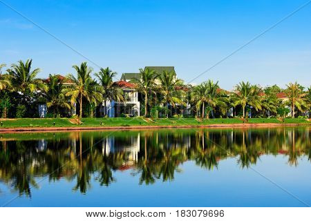 beautiful villas on the shore of pond
