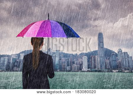 Business Woman Holding Umbrella With Falling Rain At Victoria Harbour, Hong Kong