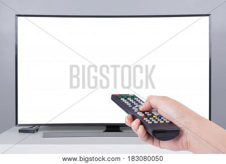 Hand Holding Tv Remote Control With Led Tv And White Screen