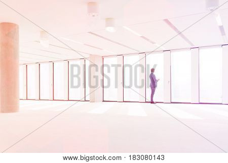 Mature businessman visiting empty office space