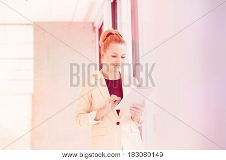 Young businesswoman using digital tablet in new office