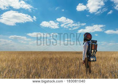 Little boy with a backpack and helmet outdoors