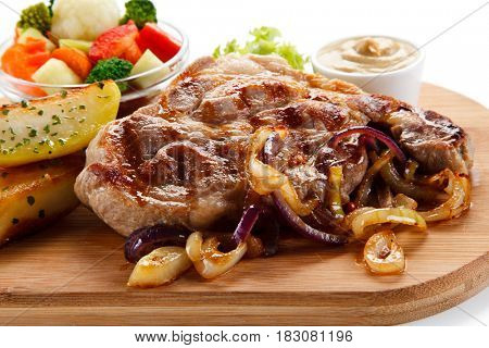 Roast steak on cutting board