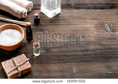 spa cosmetics set with soap, salt, oil on wooden desk background space for text