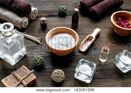 bathroom salt and natural soap for spa set on wooden table background