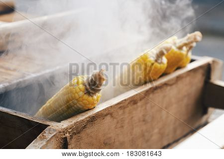 Corn cobs boiling in hot water in japan