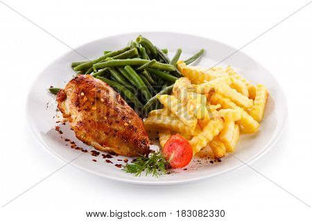 Roast chicken fillet with french fries