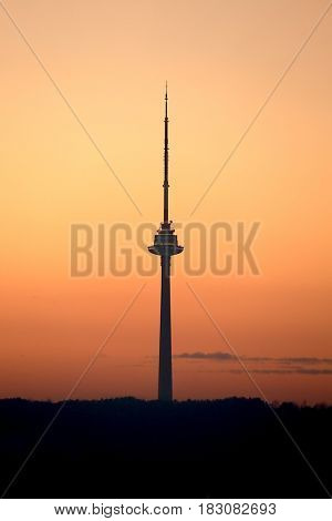 Tv tower silhouette against sunset sky