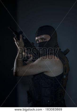 Enemy, Terrorist, a man dressed in a bulletproof vest and balaclava, is armed with pistols and machine guns