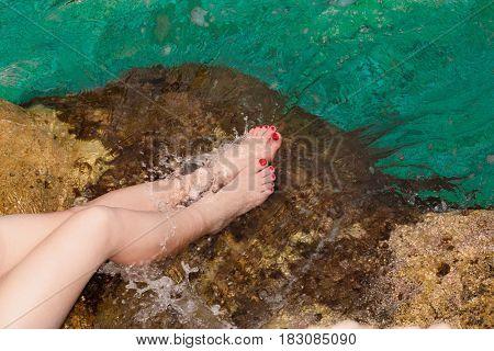 Feet girl on the sea water