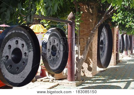 The reverse side of a row of Buddhist gongs.