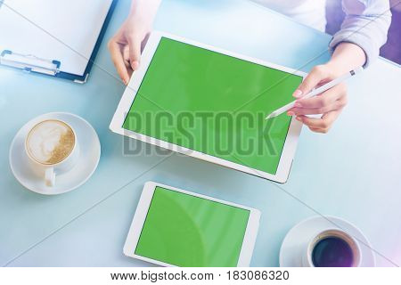 Woman showing a project with tablet pc. Top view. Clipping path included.