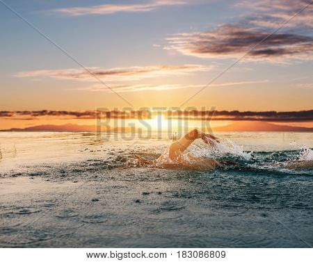 Swimming under sunset sky in summer, at tropical