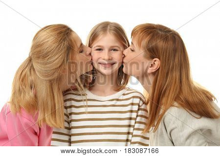 Cute girl with her mother and granny on white background