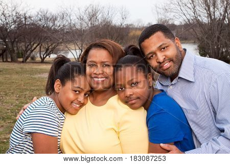 Portrait of an African American family and their children.