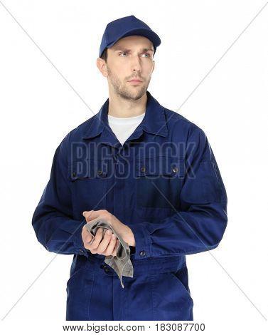 Handsome auto mechanic on white background