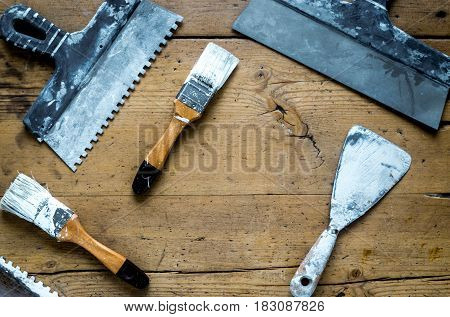professional builder work desk with house renovation instruments on wooden background top view mock-up