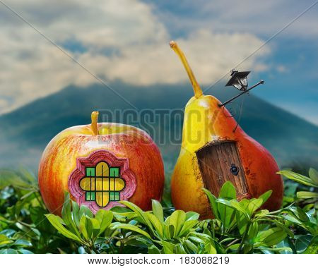 Surreal photo manipulation of a pear and apple fantasy house with door, window, lamp post, and a volcano in the background