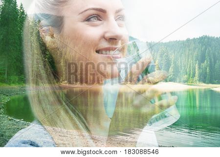 Double exposure of landscape and young woman drinking water