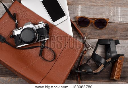 Clothing For Woman And Fashion Accessories: Bag, Sunglasses And Camera