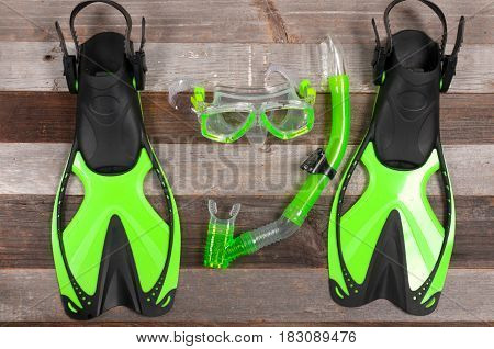 Flippers, Mask And Snorkel On A Wood Background