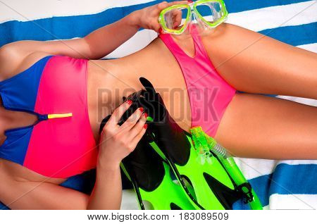 Woman In Bright Swimsuit With Mask,  Snorkel And Flippers.
