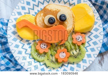 Funny elephant pancakes with fruits for kids breakfast