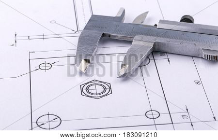 Old metal caliper and engineering drawing .