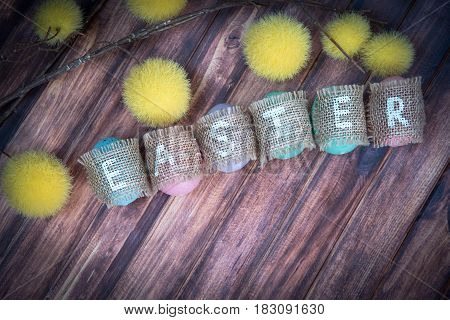 Easter concept: inscription Easter consisting on sacking and copy space. wooden background