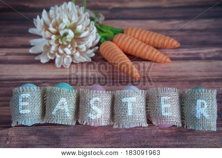 Easter concept: inscription Easter consisting on sacking. On wooden background waith copy space